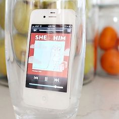 Put your phone in a glass to make the music loud enough to fill the room. BRILLIANT.
