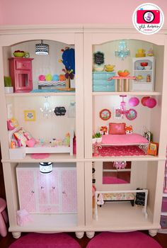 american girl dollhouse made from tall book shelves: great idea but how's she going to reach the top floor? Hmmm...