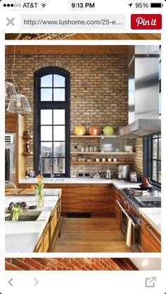 like the brick with black window trim, wood cabinets with grain and white counter