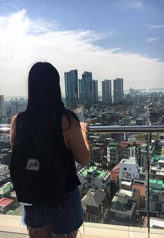 Carrie Campfire wearing our Boardwear rucksack in black in Seoul, South Korea.