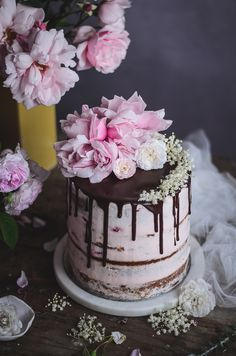 Almond, orange blossom & cardamom naked cake with strawberries and vanilla mascarpone cream
