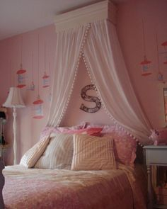 chic and sophisticated canopy idea...not loving the paint job but the box near the ceiling for the canopy could work!