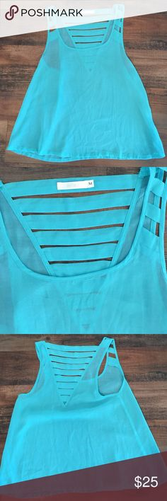 LF Millau blue strappy tank LF Millau Blue strappy tank.  Great condition! Perfect summer staple piece! LF Tops Tank Tops