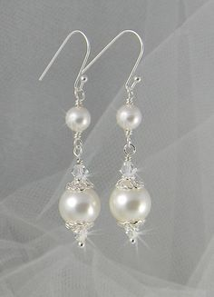 Bridal Earrings Long Dangle Pearl wedding earrings Swarovski Wedding jewelry, Swarovski Pearls, Swarovski Crystals, Abigail Earrings. $26.00, via Etsy.