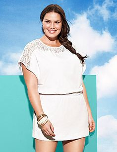 An essential for your beach bag, our crochet swim cover up adds a touch of elegance to your swim ensemble. Sheer crochet top and knit skirt are lightweight for warm, sunny days. Detailed with short sleeves and an elastic waistband. Makes a lovely layering piece over a cami, too! lanebryant.com