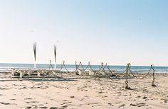 "beach aisle decor: use shepherds hooks and ""string"" rope to make an aisle"