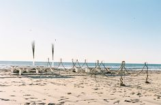 "beach aisle decor: use shepherds hooks and ""string"" rope to make an aisle"