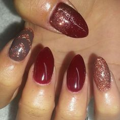 Red and brown shellac on stiletto nails. Rose gold glitter.  Instagram @boop711