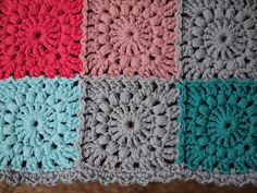 Love the idea of blocking an entire granny square in one color but using many matching colors throughout  the whole afghan (also love these colors!)