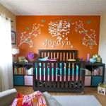 Great use of space with crib and shelves one one wall