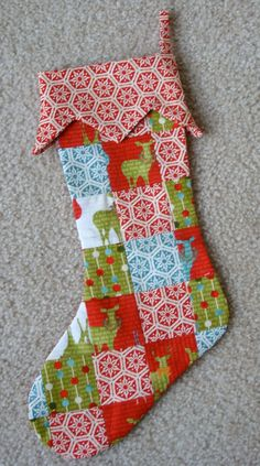 patchwork Christmas stocking. Should be personalized for each kid.