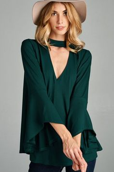 Super trendy top with attached choker and 3/4 bell sleeves. Such a fun addition to any long sleeve! Button snap closure at back of neck. Super soft material Small modeled