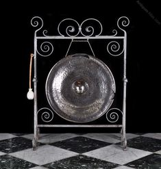 Antique Gongs, A Bronze And Wrought Iron Dinner Gong. A bronze and wrought iron dinner gong in the Arts and Crafts manner together with the striker. The hammered gong has sections neatly cut out supposedly to change the resonance. Art Deco Furniture, St Michael, Get Directions, Wrought Iron, Decorative Items, Art Nouveau, Arts And Crafts, Bronze, Dinner