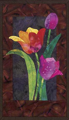 Tulip quilt. I wonder if I could do this with water colors and cut the flowers out. I think it would be pretty.