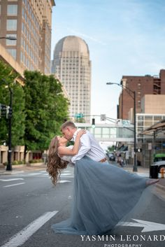 Downtown Winston Salem - Winston Salem Engagement Session - Winston Salem NC - Engagement Session at Bailey Park - The Millennium Center - NC Wedding Venues - How to Engagement Session - Yasmin Leonard Photography-15.jpg