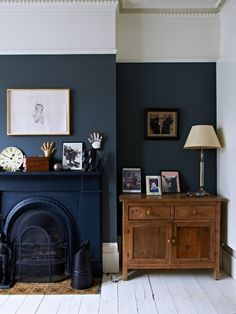Dark walls, and a dark fireplace, in Kate Watson-Smyth's home.