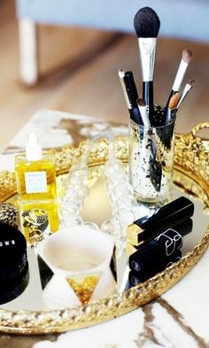 Organize your makeup like a fashion girl. We love this chic usage of a mirror tray....