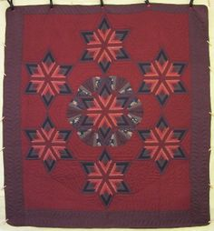 (http://www.amishquilter.com/fan-star-patchwork-amish-quilt-106x113/)