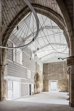 Completed in 2016 in Vilanova de la Barca, Spain. Images by Adrià Goula . The Old Church of Vilanova de la Barca  The Old Church of Vilanova de la Barca (Lleida, Spain) is a 13th-century Gothic building that was partially...