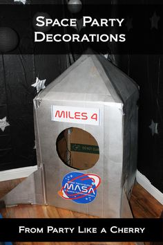 Space party decoration ideas, free printables and even a video tour of our space party set up! Instructions on how to make a rocket ship out of a refrigerator box and more! Visit the site now for more details. Outer Space Crafts, Space Crafts For Kids, Outer Space Party, Outer Space Theme, Space Theme Decorations, Diy Party Decorations, Space Theme Parties, Alien Party, Nasa Party