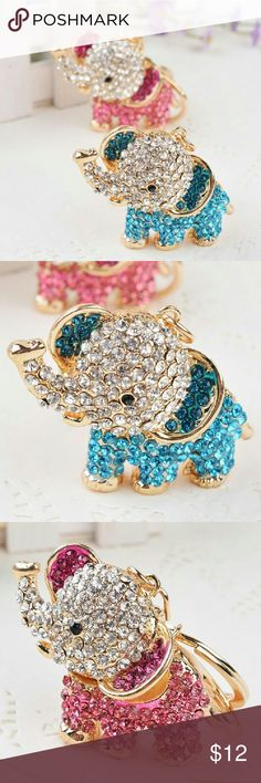 A charming Elephant Keychain/Key Ring A very cute and charming keychain !! It has white colored  crystals on front and lovely designs on back !! Very well made and high quality!! Foxy's Jewelry Accessories Key & Card Holders