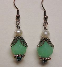 Past Time Earrings - These earrings are created with Swarovski crystals and glass beads.