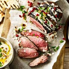 Moroccan lamb with pomegranate, pistachios and fattoush salad - Sainsbury's Magazine