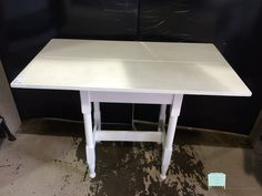 "White Work/Craft Table This white solid wood table is perfect for the patio area when repotting flowers or in a craft room for extra crafting space. It could also work in a child's bedroom as a homework table or in a spare bedroom to display a pretty floral. Dimensions are 40"" x 22-1/2"" x 30-1/2"". http://stores.myresaleweb.com/the-perfect-piece-home-furnishings/item/white-work-craft-table?id=53190"