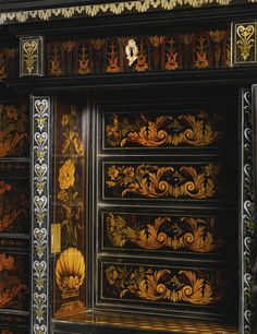 A PEWTER, BRASS, FRUITWOOD AND STAINED SYCAMORE INLAID MARQUETRY, EBONY AND EBONISED CABINET ON STAND ATTRIBUTED TO PIERRE GOLE (1620-1684) LOUIS XIV, CIRCA 1680 the upper section of breakfront form with three frieze drawers inlaid with lunettes and bellflowers above a cupboard door inlaid with a vase of flowers on a plinth opening to reveal a fitted interior with four drawers and a parquetry floor above a further drawer flanked by panels with a ribbon-tied floral bouquet above a stylised…