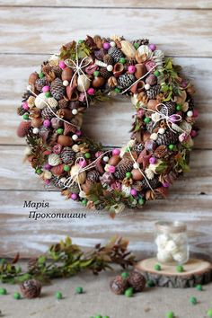 A wonderful wreath Berry consists of lots of natural materials. It will be a great supplement for your interior.All of these materials ( casuarins bumps,acorns,round bumps, flowers ,cottonweed,dried roses ,decorative balls )are perfectly combined together . I have used also pink