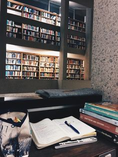 Studying in the library uploaded by Thalia on We Heart It