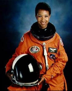 Dr. Mae C. Jemison. The first African American woman to travel in space. After returning from her historic flight aboard shuttle Endeavour, on September 12, 1992, she was greeted by over 20 Tuskegee Airmen welcoming her home. I wish we would hear more about people like her. Such an inspiration. And yes she's the real deal and not some flat earth hoax. http://www.biography.com/people/mae-c-jemison-9542378