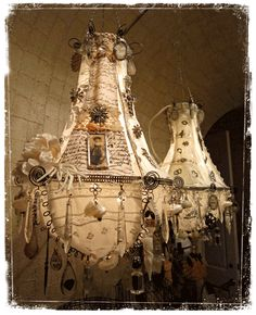 WOW....handcrafted chandeliers! These would be AMAZING in my studio!
