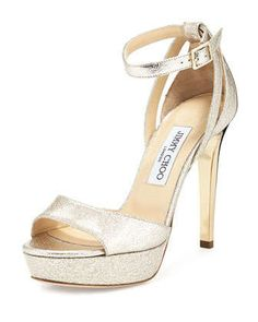 "Jimmy Choo textured metallic patent sandal. 4.5"" golden heel. Tapered toe strap. Adjustable ankle-wrap strap. Golden hardware. Leather lining and sole. ""Kayden"" is made in Italy."