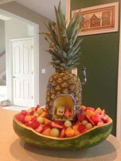 How fun would this fruit bowl be for yummy appetizers and cute party decor! SpongeBob Fruit Bowl perfect for a kids SpongeBob themed birthday party!