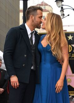 Actor Ryan Reynolds kisses his wife Blake Lively during the Deadpool actors Hollywood Walk of Fame ceremony in Hollywood, California on December 15, 2016. / AFP / Mark RALSTON