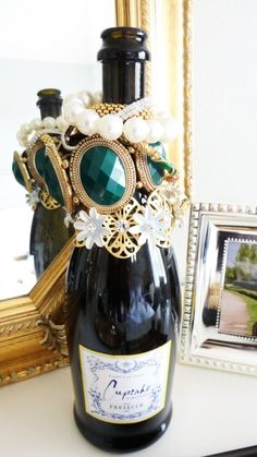 Repurpose wine bottle into bracelet holder/display (and corks to hold rings/earrings). Genius idea for the bottle of champagne I've been holding onto.