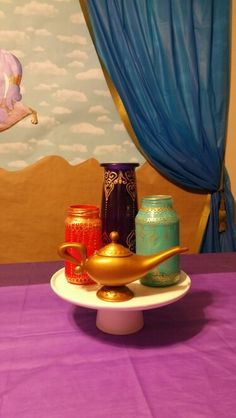 Aladdin / Jasmine themed birthday party. Decor ideas.  DIY Moroccan lanterns. Puffy paint.  Genie lamp.