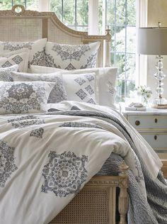 Layers of hand-embellished velvet, taffeta with applique and embroidery impart an artisanal quality to the Calabria Bedding Collection.