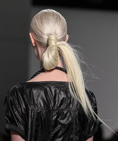 Inspired by the classic topknot, Macadamia Professional's ambassador Giannandrea Marongiu used their products to do 'the back knot', a lower version. Using hair extensions for length, he basically created a loop with the models' ponytails and then tied it back on itself at the ponytail base, concealed with a small section of loose hair. Cool!