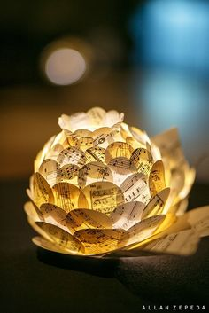 """Artichoke"" Lantern Centerpieces by all things paper - Sheet music layered over a lantern base with a battery operated tea light."