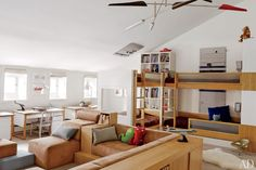 Leroy Street Studio Designs a Modern Manhattan Townhouse : Architectural Digest. Bunk beds and desks by Nurseryworks and a custom-made Vladimir Kagan sectional sofa were specified for the boys' room; the David Weeks Studio chandelier is from Ralph Pucci International.