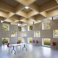 Salmtal Secondary School Canteen by SpreierTrenner Architekten, Glulam beams, tectum acoustical ceiling panels, concrete floors