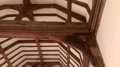 Detail view of the exquisite oak crown post roof at Friston church, Sussex. Mouldings on the tie beam and wall plates, made up of cyma, cavetto and ogee profiles, create an undulating delight of light and shadow. Oak Framed Buildings, Light And Shadow, Plates On Wall, Tudor, Beams, Most Beautiful, Crown, Tie, Detail