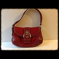 Authentic Red Soho Coach Purse Very nice Authentic Coach purse. Lining in excellent condition. Small scratch on front, please see picture.  Approx 10 in x 7 in. Coach Bags