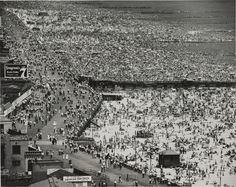 'Sunday at Coney Island Beach, New York' (July 4, 1949) by American photographer Andreas Feininger (1906-1999). Gelatin silver print, 16 x 20 in. collection: The Baltimore Museum of Art. via BMA blog