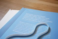 hold a booklet together with a rubber band
