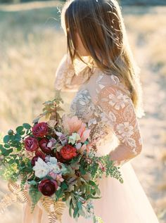 11 Wedding Dresses with Simply Stunning Sheer Sleeves | Pick a wedding dress that includes elements of your wedding theme. It could be something as simple as a color. You could take it one step further and have dress details that match the bouquet you'll be carrying.