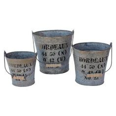 Stenciled latitude and longitude of Bordeaux, France on vintage buckets.