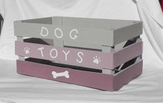 This dog toy box is made using a reclaimed wood crate. It is painted with a satin paint in grey, lavender, and purple with white letters and accents. This makes a great storage container for your dogs many toys and belongings. Your child will have fun lea